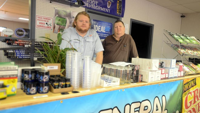 Jackson Organics and Home Brew owners Jason Arnold and Brad Woods stand behind the counter of their business.