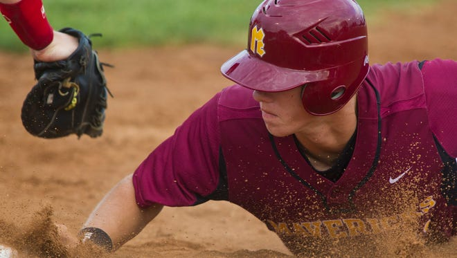 McCutcheon's Logan Sowers makes it back to first safely during their sectional final game against Logansport  Monday, June 2, 2014, at Loeb Stadium in Lafayette. McCutcheon won 2-0 to advance to the regional bracket.
