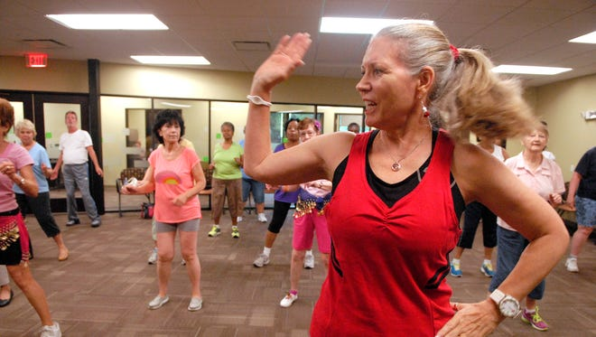 Zumba Gold instructor Susan Hinderer leads a class at the Humana Guidance Center on Hikes Lane recently.