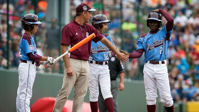 Taney Youth manager Alex Rice, a Montgomery Bell Academy graduate, congratulates Zion Spearman after a hit during the Little League World Series.