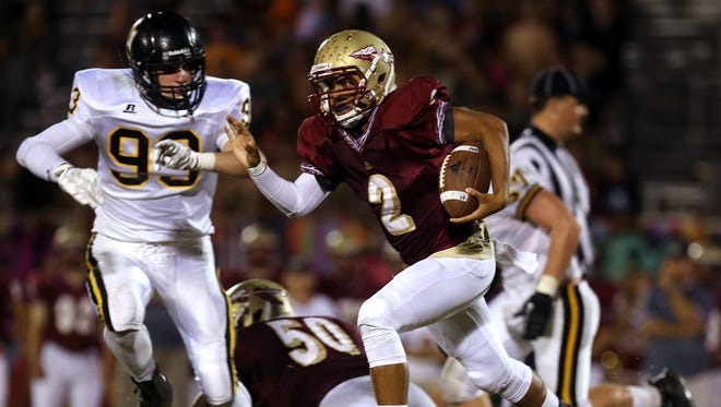 Riverdale quarterback Cortland Owens runs the ball against Hendersonville in the second half Friday.