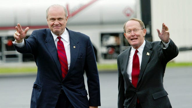 U.S. Senate candidate Lamar Alexander, right, waves as he arrives with Senator Fred Thompson in Nashville, Tenn., Monday, Nov. 4, 2002. Alexander is spending his last campaigning day flying around the state with outgoing Senator Fred Thompson.