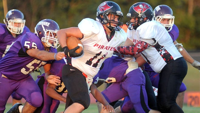 The Mount Gilead Indians hosted the Cardington Pirates in Mid Ohio Athletic conference football action Friday night, Sept. 19, 2014. Cardington won 21-7.