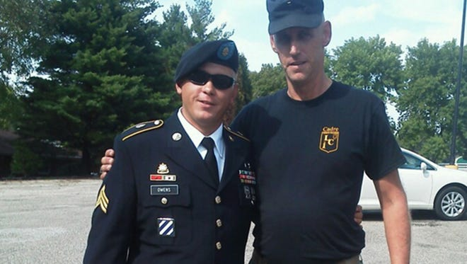 This undated family photo provided by Glen Welton shows U.S. Army Sgt. Tim Owens, left, of Effingham, Ill., with his cousin Glen Welton. Owens was one of three people killed by a shooter at Fort Hood, Texas on Wednesday, April 2, 2014. The shooter, identified as Ivan Lopez, also wounded 16 others before shooting himself, according to authorities.