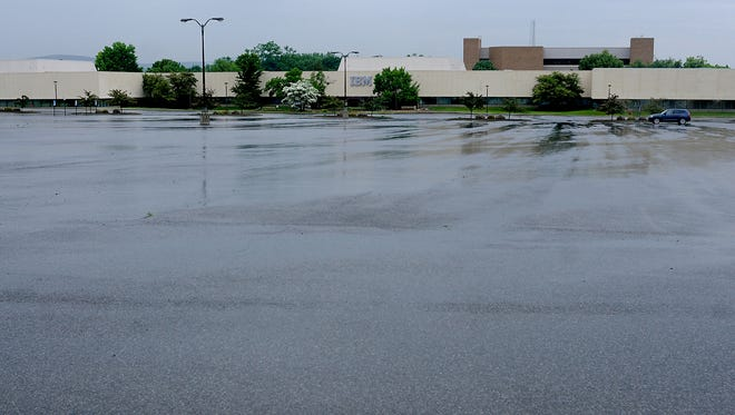 A lone car is parked in the IBM parking lot where Building 415 is located, adjacent to IBM Road in the Town of Poughkeepsie.