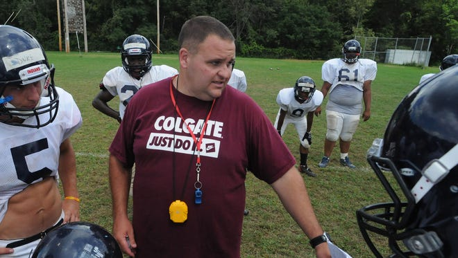 Pat Keevins coaches the Roy C. Ketcham High School football team in practice on August 27, 2012, in Wappingers Falls