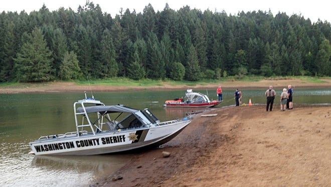 This photo provided by the Washington County, Ore., Sheriff's Office shows a search underway at Henry Hagg Lake.