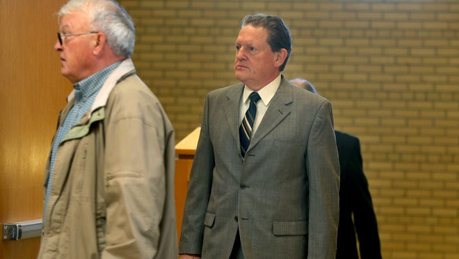 Byron Smith, center, makes his way through security at the Morrison County Courthouse, Monday, April 21, 2014, in Little Fall, Minn. The 65-year-old faces two counts of premeditated first-degree murder for the killings of Haile Kifer, 18, and Nick Brady, 17, who broke into his home on Thanksgiving Day 2012.