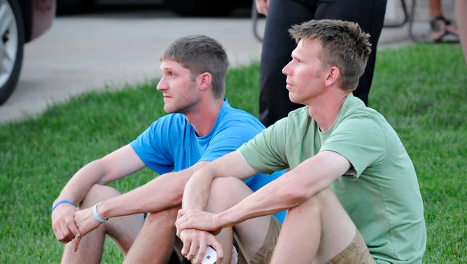 Homeowner Jeff Hille (right) sits with his brother in law Kole Heckendorf as they watch a fire destroy the home after a plane crashed into the home at 731 Garden Place in Sauk Rapids Friday, June 20.