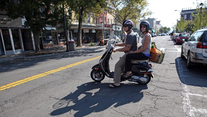 Steven and Evelina Quinones head to their next stop after the Nyack, N.Y., farmers market. Nyack is filled with specialty shops.