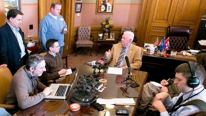 House Speaker Ray Merrick, R-Stilwell, center, speaks to the media in his statehouse office, Friday, Feb. 14, 2014 in Topeka, Kan.