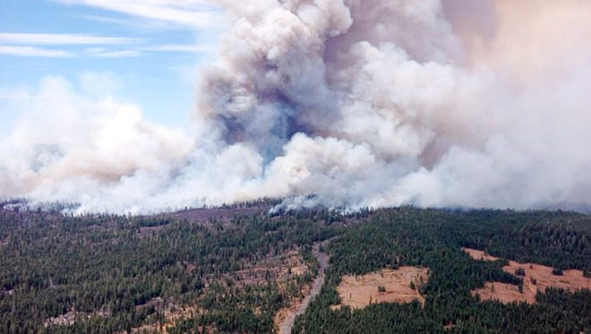 This Aug. 1, 2014, photo provided by the U.S. Forest Service shows the Eiler Fire burning Old Station, Calif. The Eiler Fire has consumed nearly 36 square miles and destroyed eight homes in the process, according to fire officials, Sunday Aug. 3, 2014.