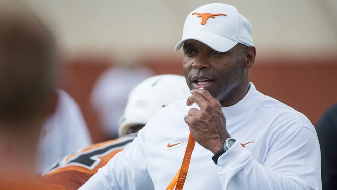 University of Texas NCAA college football head coach Charlie Strong watches a morning practice session in Austin, Texas.
