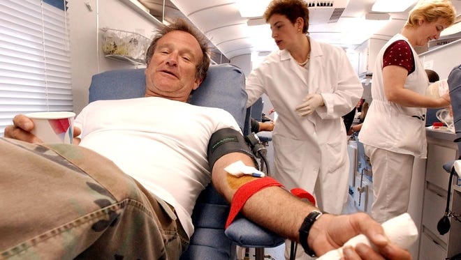 Actor Robin Williams, left, donates blood at the Irwin Memorial Blood Center in San Francisco, Tuesday, Sept. 11, 2001. Thousands of people waited in long lines to donate blood for victims of terrorist attacks in New York and in Washington. CREDIT: Justin Sullivan, AP