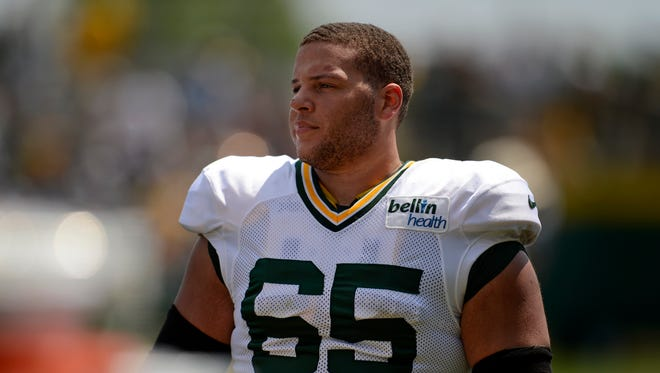 Green Bay Packers guard Lane Taylor looks on during training camp practice at Ray Nitschke Field.
