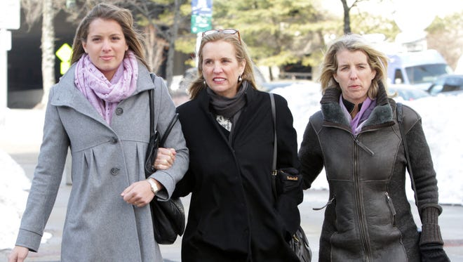 Kerry Kennedy, center, walks back to the Westchester County Courthouse Feb. 26, 2014 after lunch break in her drugged driving trial. Walking arm in arm with her is her daughter Cara Cuomo, left,  and her sister Rory Kennedy .