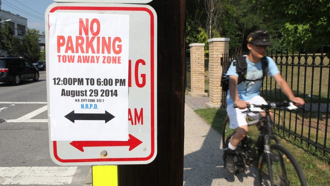 """""""No parking"""" signs are visible along Route 1/ Main Street in New Rochelle Aug. 27, 2014. They were placed in preparation of President Obama's upcoming visit to the area."""
