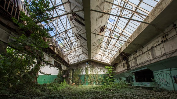 The indoor clay tennis courts of William du Pont Jr.'s former estate that is now Bellevue State Park sit completely overgrown with vegetation. The poor design of the overhead skylights led to damage from snow accumulation in the 1990's and further damage from vandals led to the permanent shut down of the building. The building is slated to be demolished.