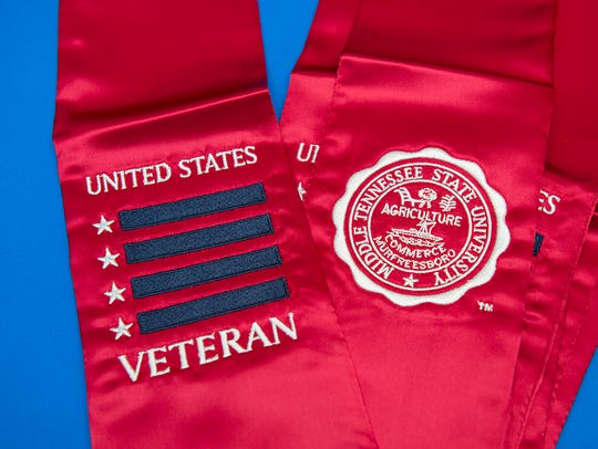 Graduating MTSU veterans receive a red stole to wear