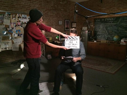 Mark Mathis checks his script during the shooting of