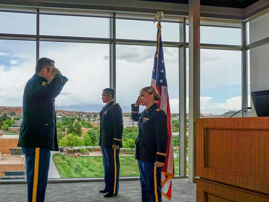 Second Lt. Bre Opdahl receives her first salute during the Dixie State University Army ROTC officer commissioning ceremony May 6.