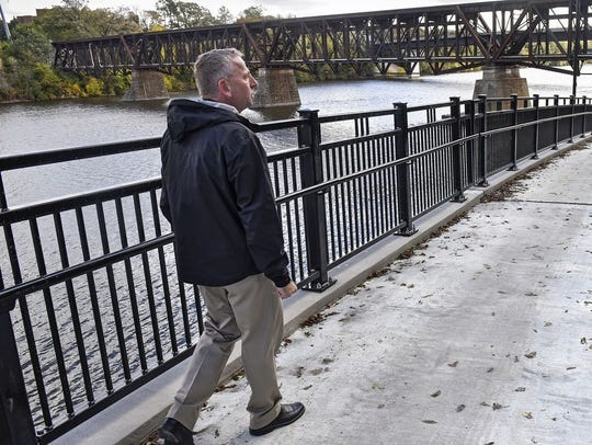 Mayor Dave Kleis walks on a trail.