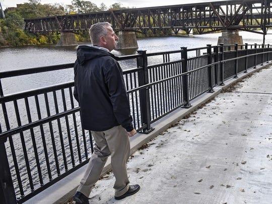 Mayor Dave Kleis walks on a trail.