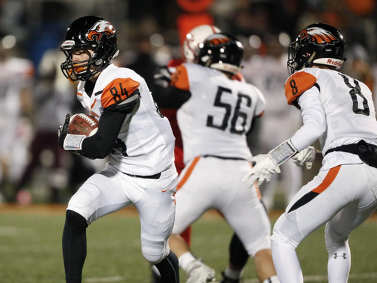 Jace Andregg (84) runs the ball during a football game
