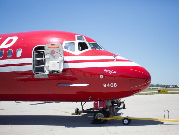 Painted in a deep TWA red, an MD-80 belonging to the
