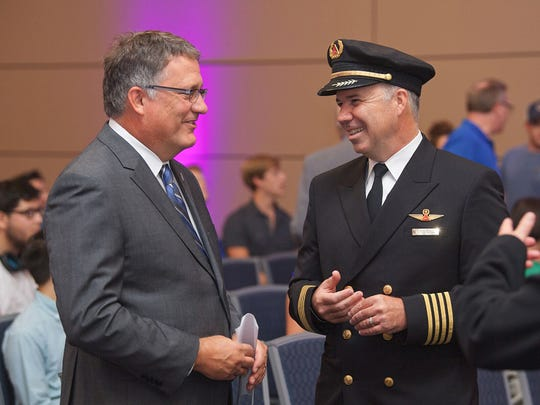 MTSU Provost Mark Byrnes, left, and Delta Capt. Patrick Burns share a laugh Aug. 31 in the Student Union Ballroom while discussing the launch of the Delta Propel program, which ultimately could land university graduates jobs with the airline or other carriers.