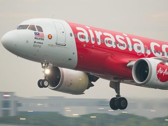 An AirAsia Airbus A320neo lands at Singapore Changi