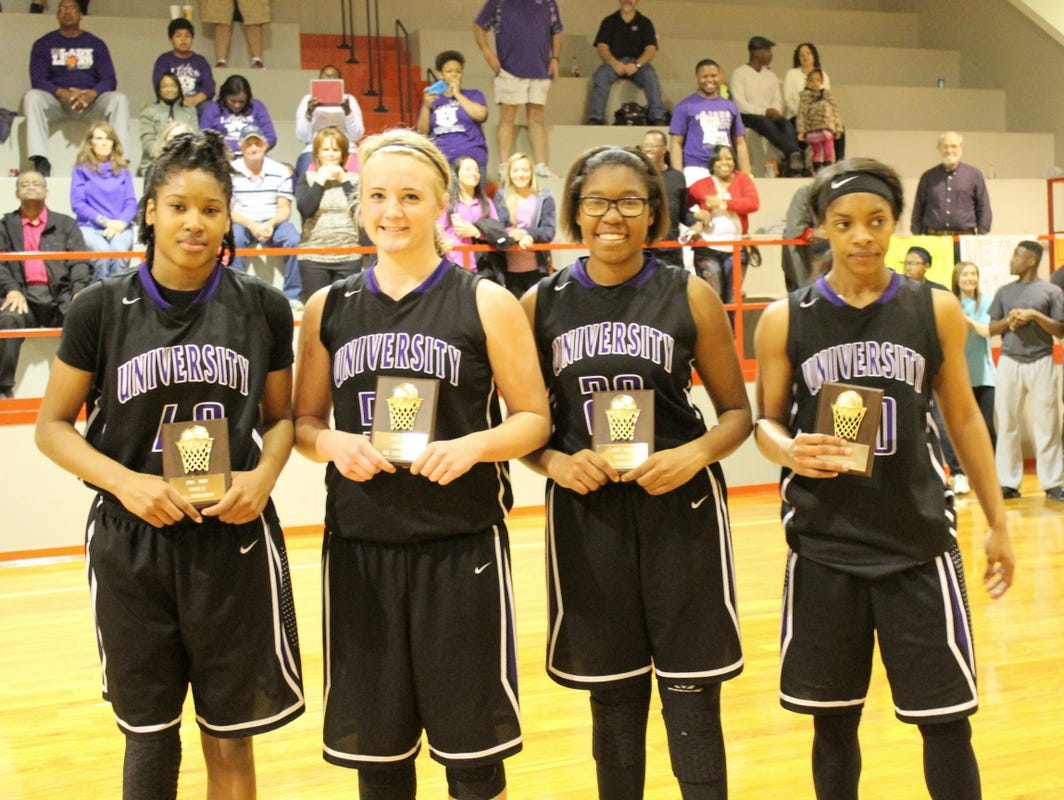University Academy had four players that made the All-MAIS Class 1A girls tournament team. From left are freshman ReJayla Williams, freshman Jordyn Cross, junior Jada Swafford and senior Courtney Branch.