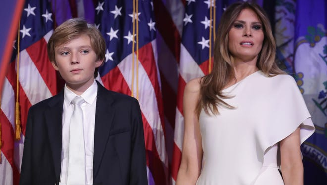 Barron Trump and his mother Melania Trump on stage on election night, Nov. 9, 2016.