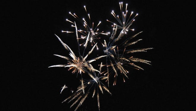 Consumer fireworks, which are illegal in Massachusetts, light up the nighttime sky.