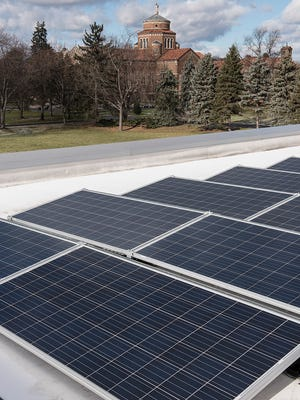 Solar panels are mounted on the roof of the Franciscan Center, Madonna's newest LEED-certified building.