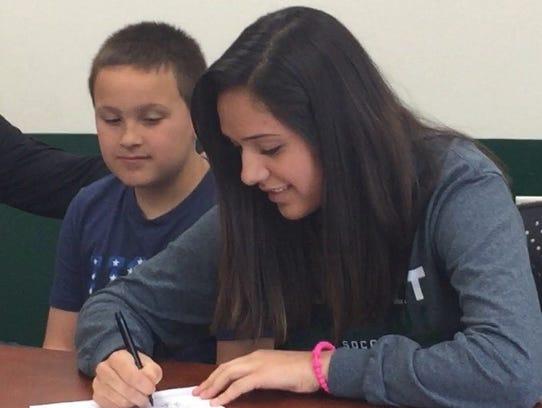 D.C. Everest senior Dorene Sanchez signs a letter of