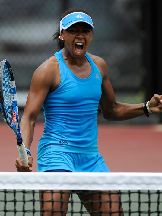 UCLA's Robin Anderson, right, reacts during the women's doubles match against North Carolina in the Division 1 NCAA tennis championship, Tuesday, May 20, 2014, in Athens, Ga. (AP Photo/David Tulis)