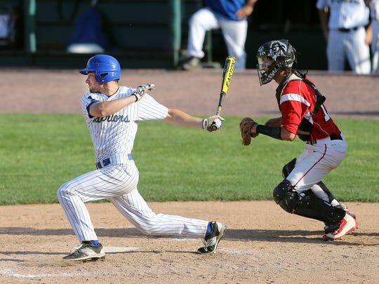 Schroeder's Shane Marshall gets a base hit against Lancaster.