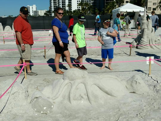 The Anderson family of Hinckey, Illinios -- Josh, Sarah, Jack and Matt -- attend the American Sand Sculpting Championship on Fort Myers Beach on Sunday.