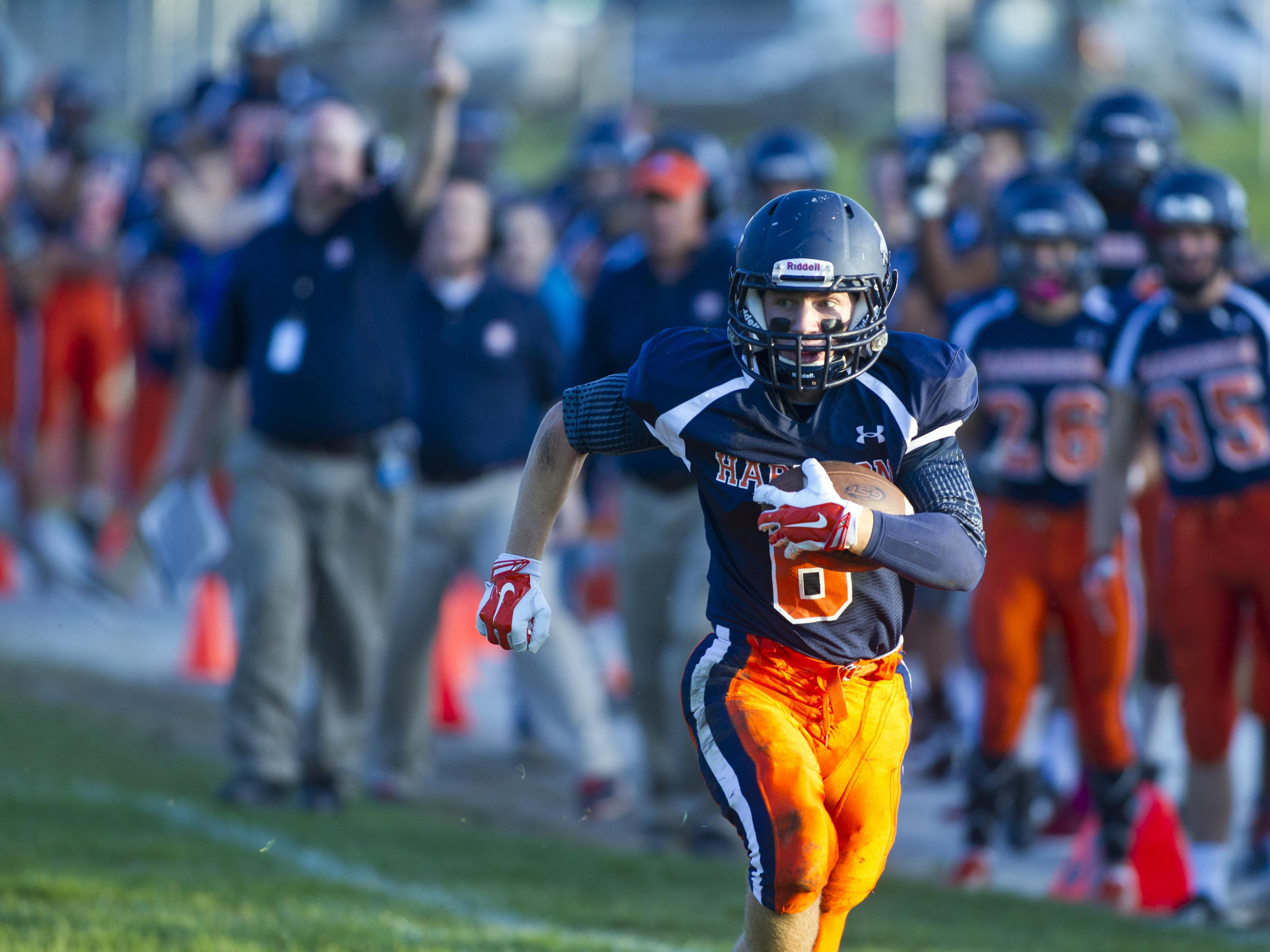 Harrison's Tanner Watkins takes off for a touchdown after intercepting a Anderson pass on Sept. 19.