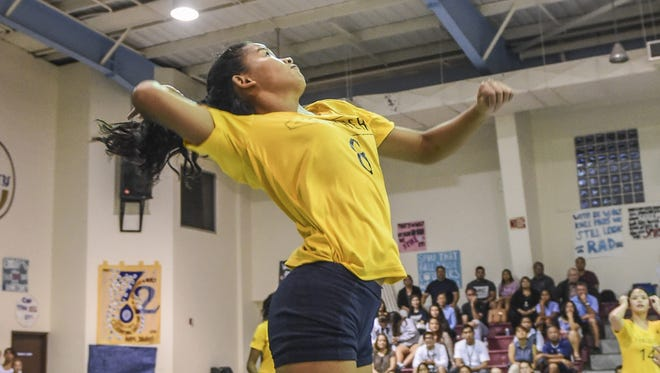 Guam High Panthers' Aubrey Taimanglo leaps for a spike against the Academy of Our Lady of Guam Cougars in the Independent Interscholastic Athletic Association of Guam Girls' Volleyball League at the Academy gym in Hagåtña on Sept. 15.