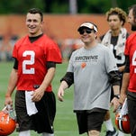 Cleveland quarterback Johnny Manziel, left, walks off the field after a June 12 mandatory minicamp practice at the Browns' training facility in Berea. Former Browns quarterback Brady Quinn recently criticized Manziel's off-the-field exploits.