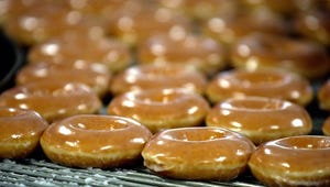 Freshly glazed donuts come off the line at a Krispy Kreme doughnut shop in Louisville, Kentucky.