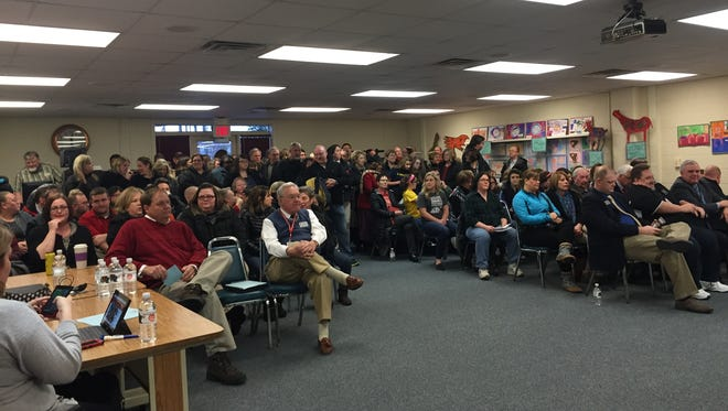 Members of the Richmond Education Association crowded the Richmond Community Schools' board room for Wednesday's board meeting to share concerns about their paychecks and other issues.