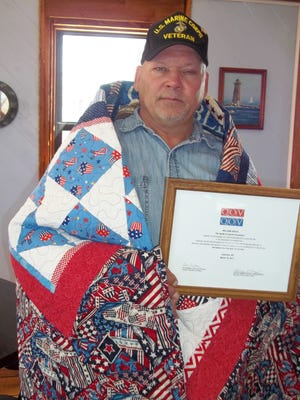 Midway resident, William Gould, a veteran of the US Marine Corps, was recently awarded a Quilt of Valor by the Mountain Home Quilts of Valor.  The ceremony was held at Beacon Point Restaurant in Lakeview with friends and guests attending.