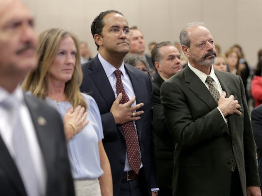 El Paso Mayor Oscar Leeser, right, and U.S. Rep. Will Hurd pause for the National Anthem Wednesday during the State of the County at the Judson F. Willims Convention Center.