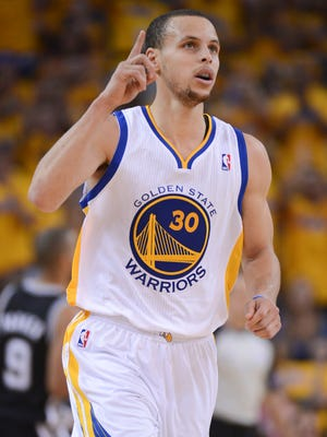 Warriors guard Stephen Curry set an NBA single-season record for three-pointers last season.