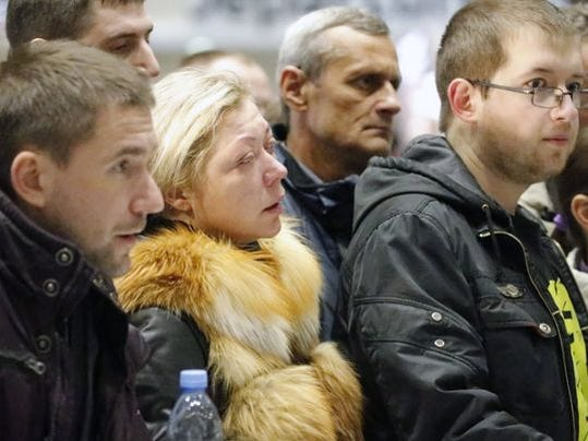 Relatives of passengers of MetroJet Airbus A321 wait at Pulkovo II international airport in St. Petersburg, Russia, on Oct. 31, 2015.