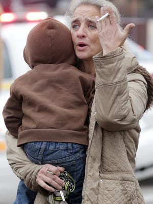 Mary Bailey of Northside holds her grandson, Gabriel McNamara, in early December as she looks for the boy's parents, Chris and Meleah. They were evacuated from the Super 8 Motel in Florence after a shootout there between police and a teenager.