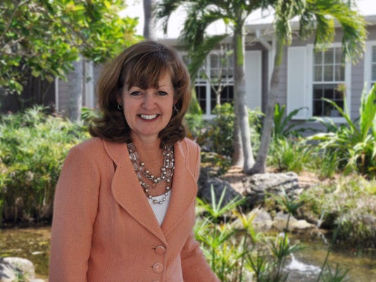 VNA-of-the-Treasure-Coast-s-new-Chairman-of-the-Board-Sue-Tompkins-in-front-of-the-VNA-Hospice-House-in-Vero-Beach..jpg